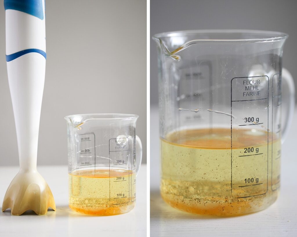 jar with oil and egg and an immersion blender