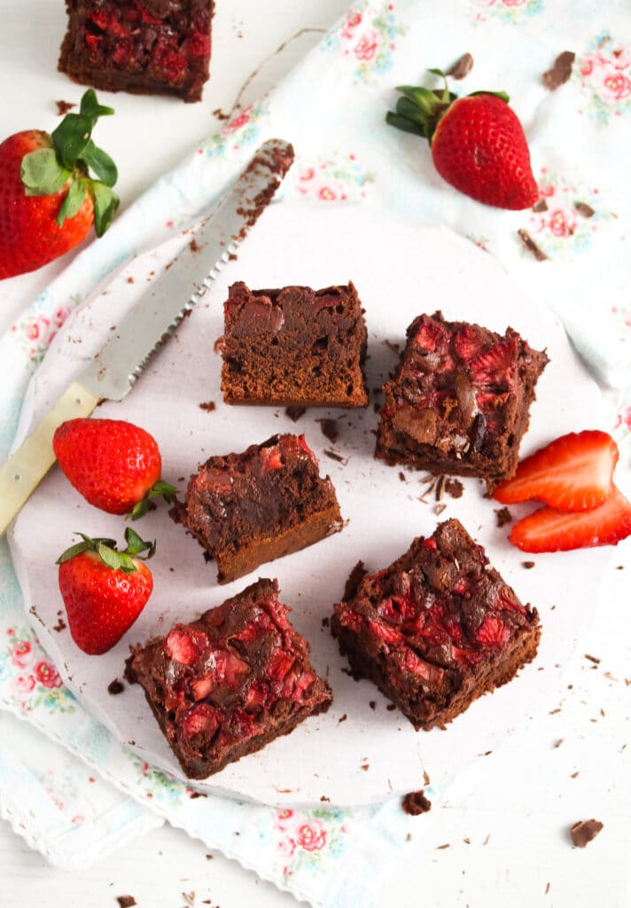 strawberries and brownies on a white wooden platter