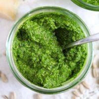 very green wild garlic pesto in a small jar.