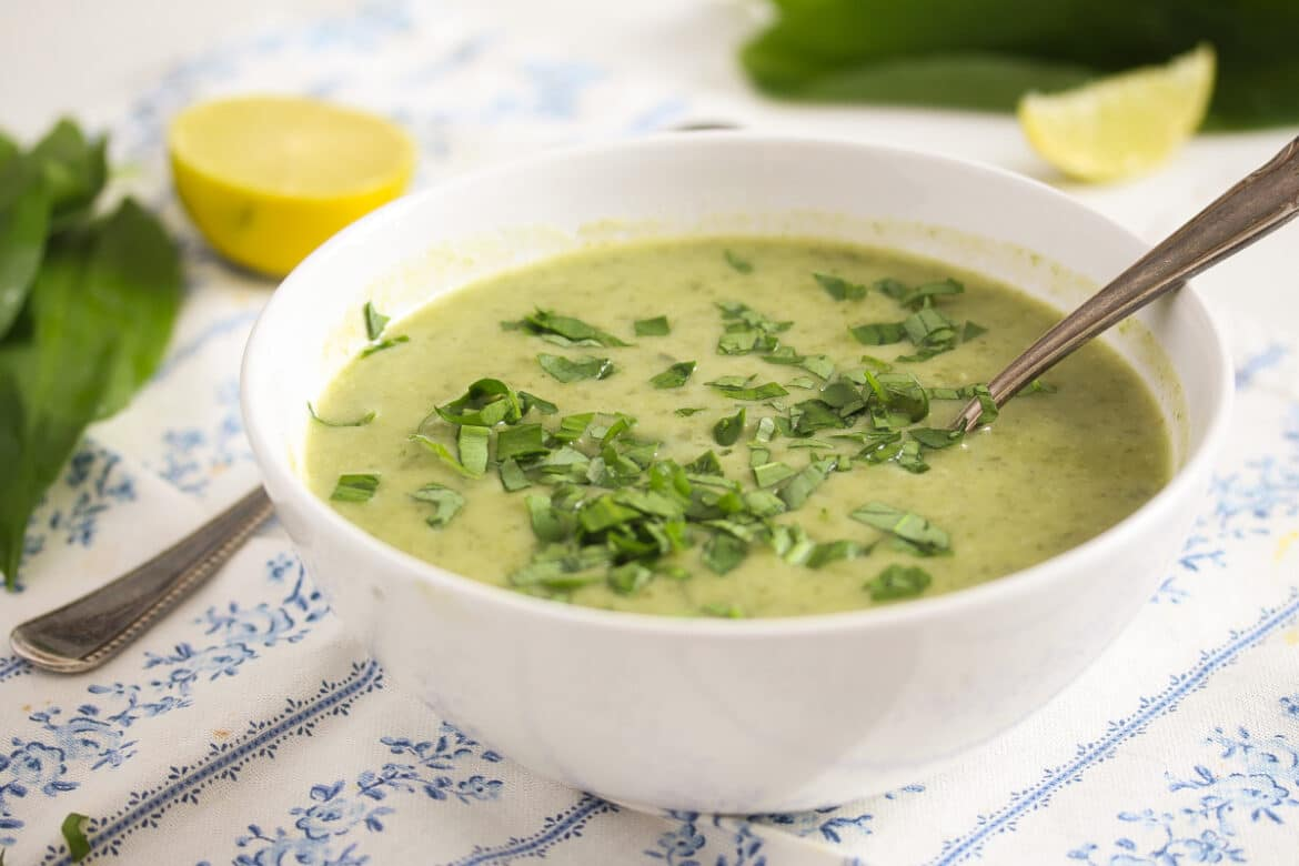 wild garlic and potato soup in a white bowl