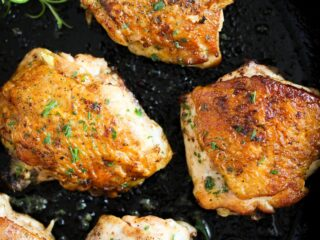 stove top chicken thighs in a cast iron skillet