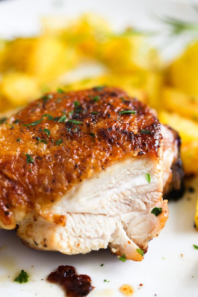 cut up chicken thigh with potatoes
