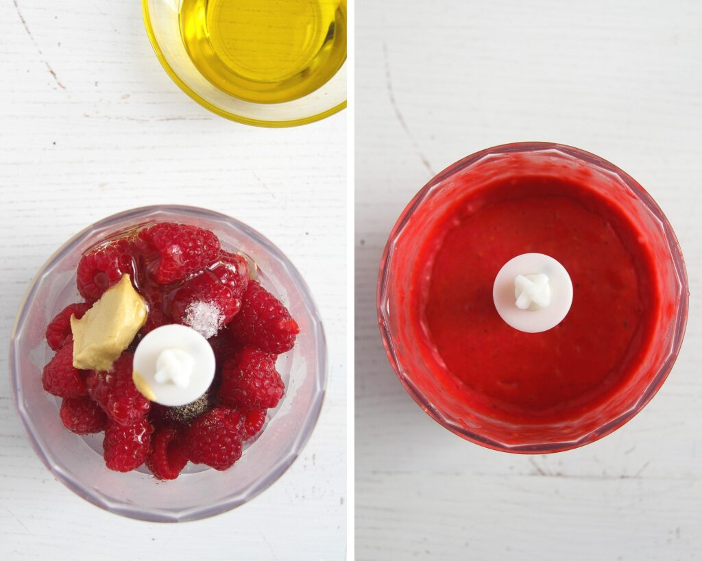 small blender with raspberries and dressing in it