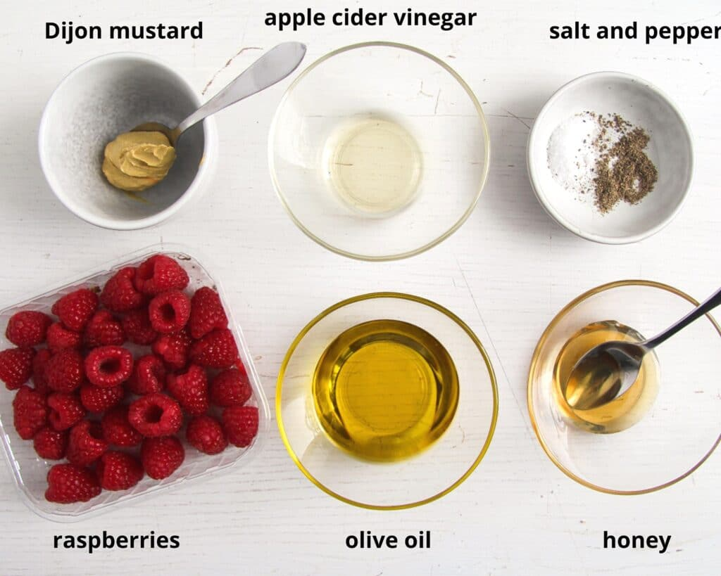 raspberries, oil, vinegar, honey, mustard for making salad dressing