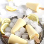 silver plate with ice cubes, lemon and popsicles