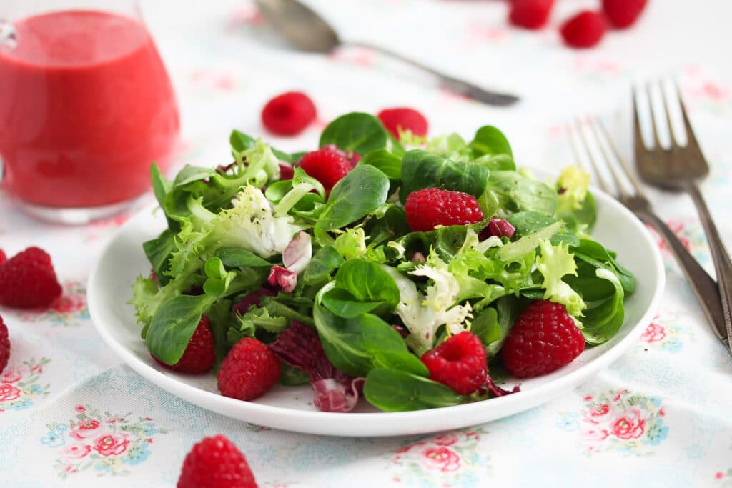 plate with salad and raspberry dressing