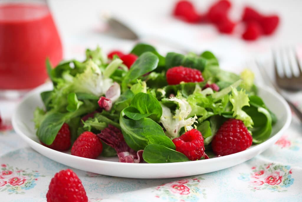 raspberry dressing with salad leaves and berries