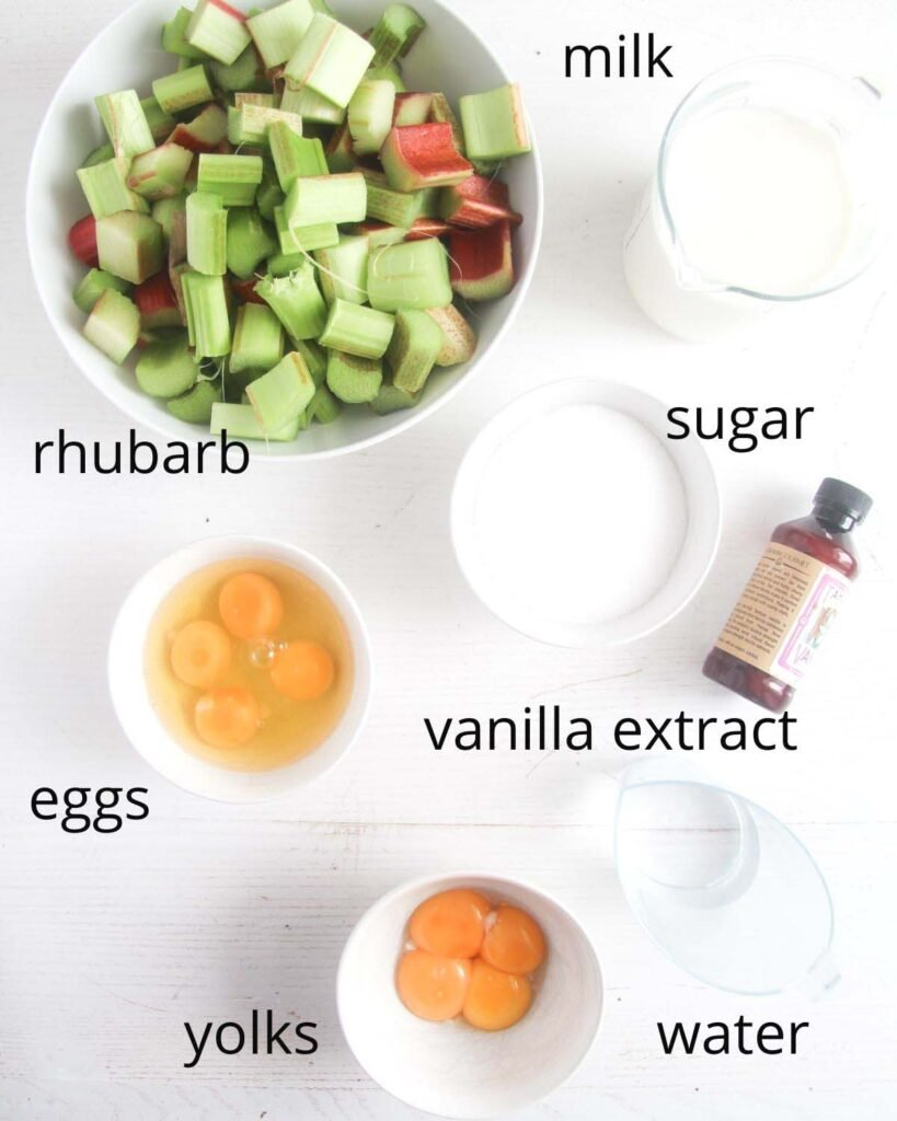 ingredients needed to make custard pudding with rhubarb arranged on a table.