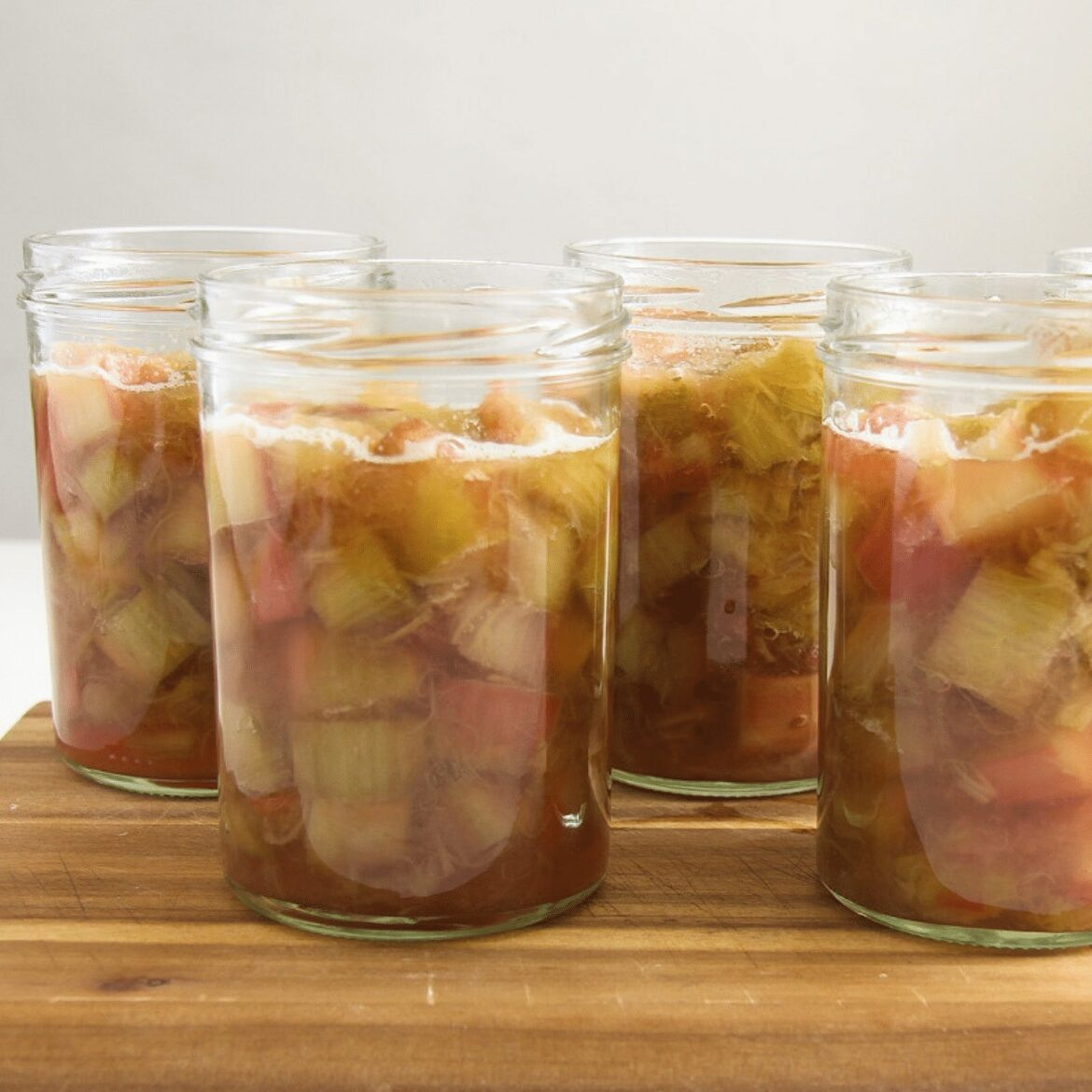 canning rhubarb in jars ready to be boiled
