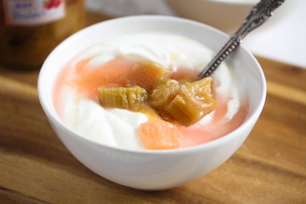 bowl of yogurt with preserved rhubarb on top