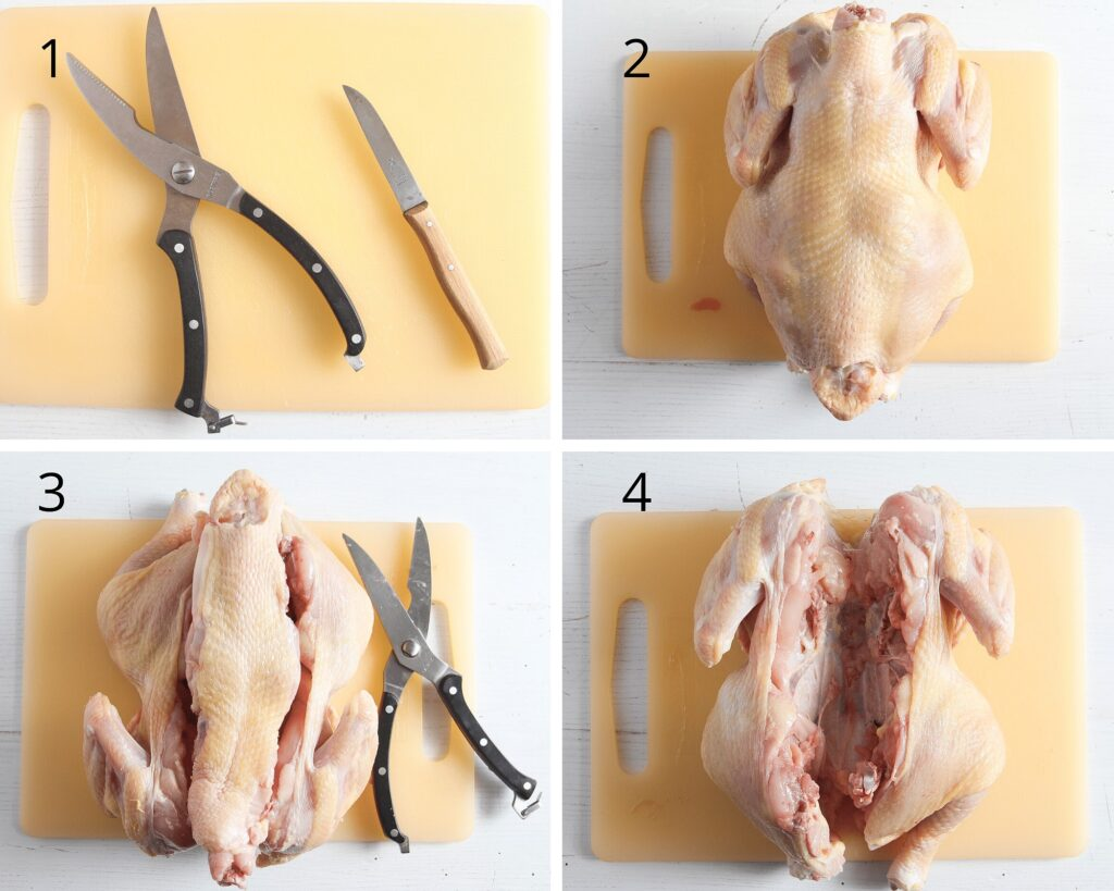 cutting a chicken in half with shears and knife