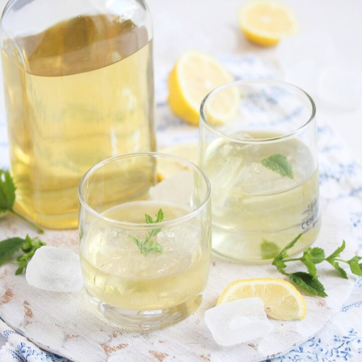 elderflower liquor with lemons in bottle and glasses