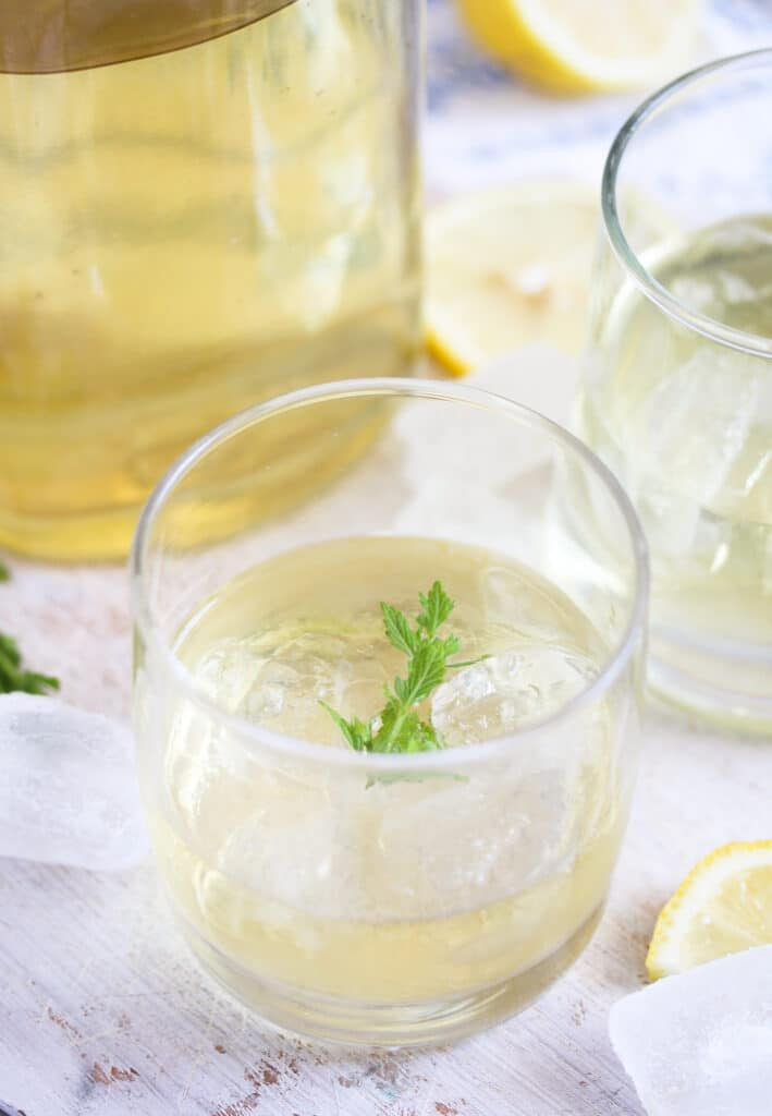 gin cocktail with lemon and elder blooms