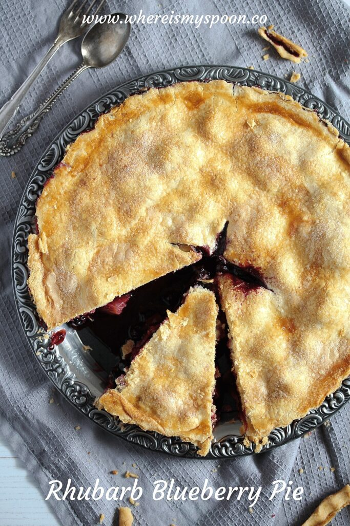 sliced pie with blueberries and rhubarb filling