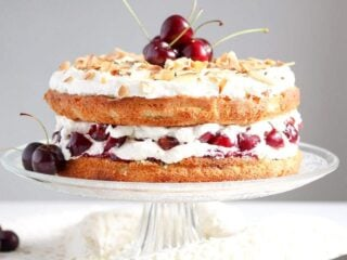 english bakewell sponge cake with cherries on a vintage platter