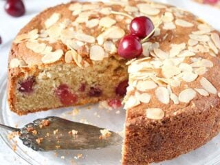 cherry and almond cake on a cake platter