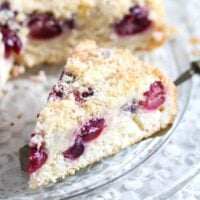 coconut and cherry cake slice being served