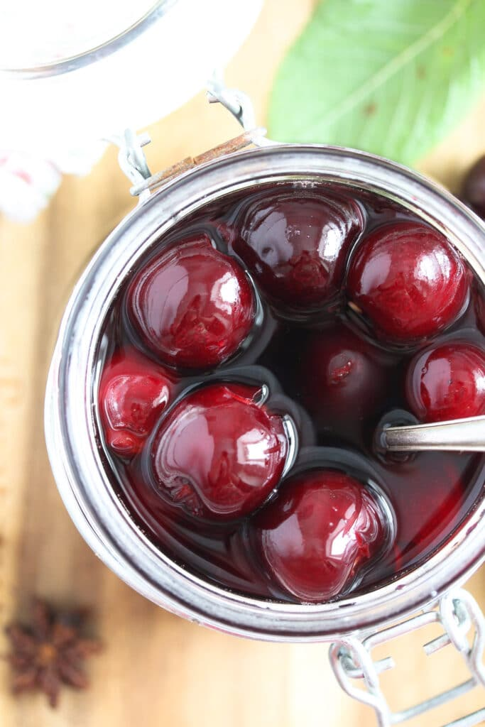 red wine cherries in a small jar seen from above