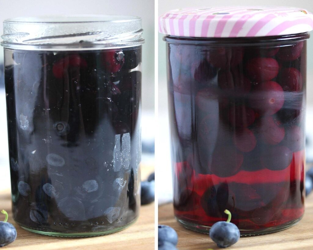 jars of blueberries before and after canning
