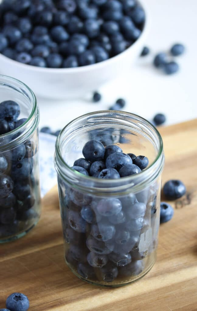 fresh blueberries in a bowl and in a jar
