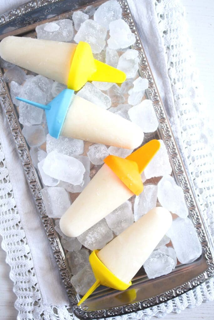 citrus pops with yogurt on ice cubes