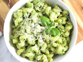 tuna pesto pasta sprinkled with parmesan in a white bowl seen from above