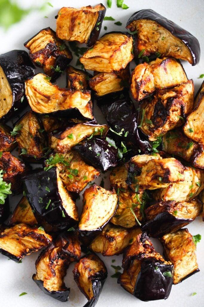 close up of shiny roasted eggplant cubes