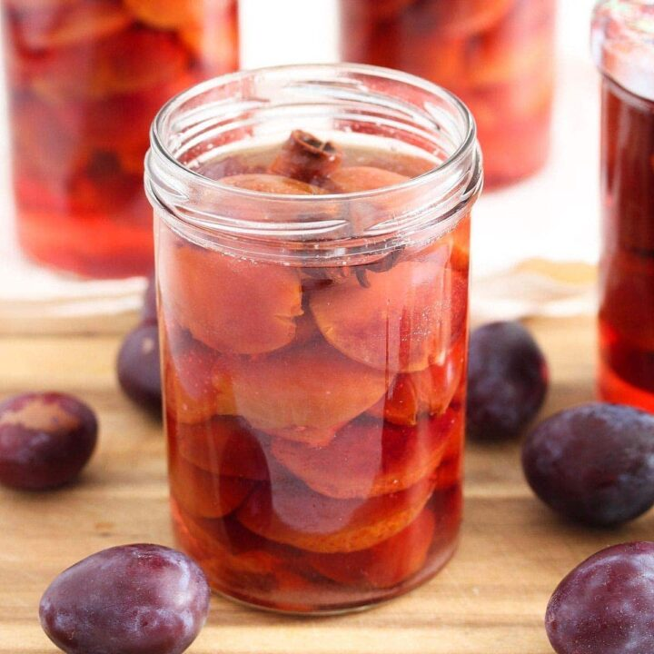 canning plums in jars with sugar syrup