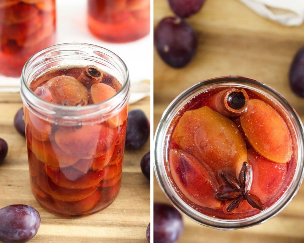 jars of preserved plums on a wooden board
