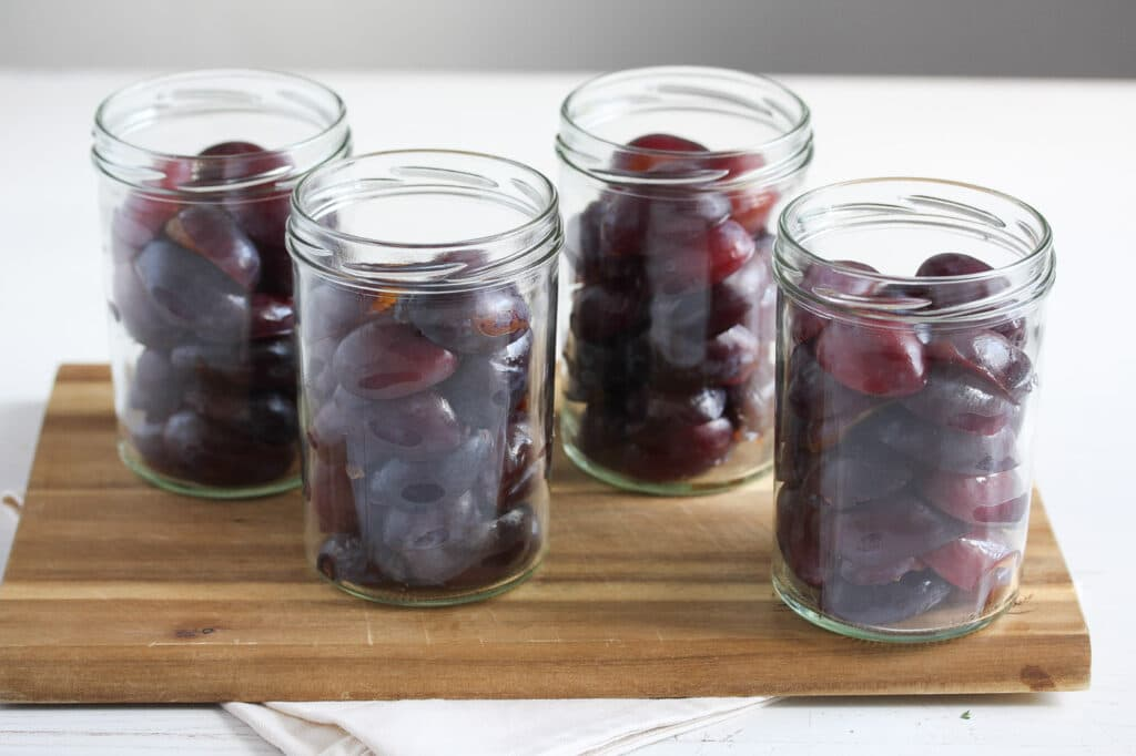 raw italian plums halved and packed in jars