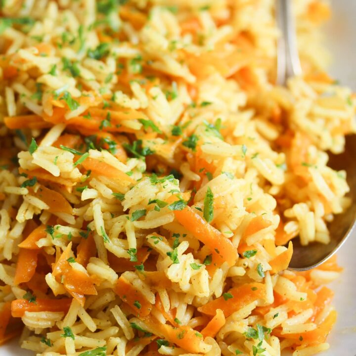 curry rice with grated carrots on a large platter