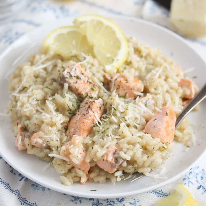 risotto with fish and dill on a white plate