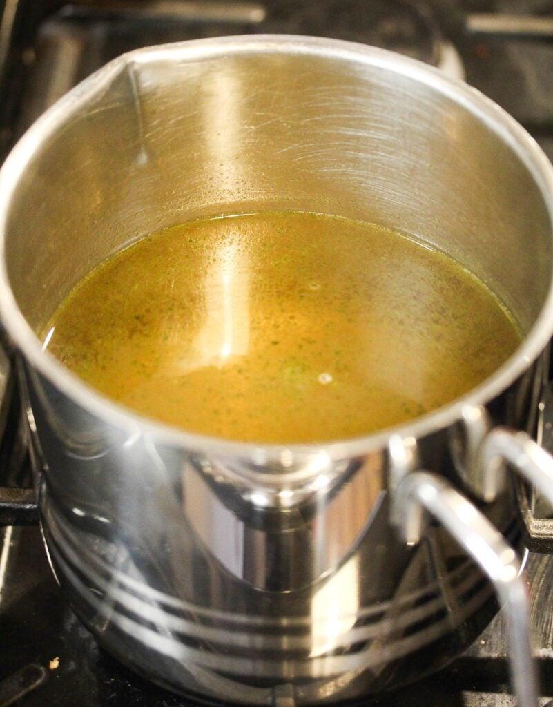 jug pot full of chicken stock