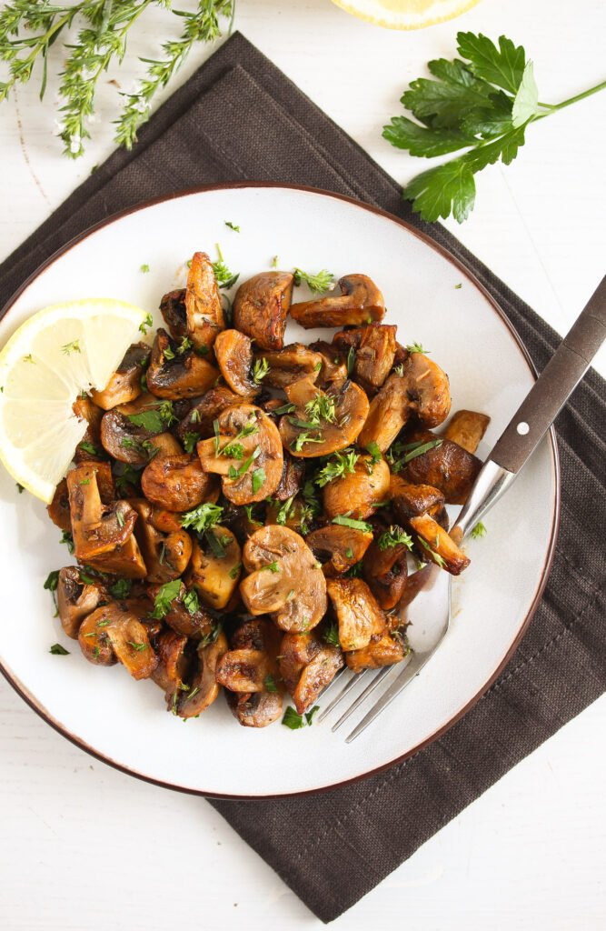 plate with air fry mushrooms on a brown kitchen towel