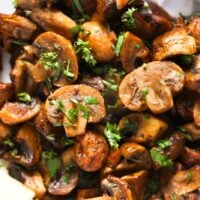close up of sliced fried mushrooms with parsley