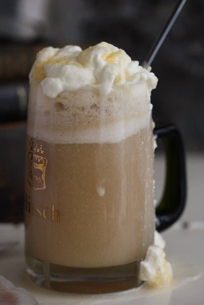 brown drink with vodka and butterschotch schnapps topped with whipped cream