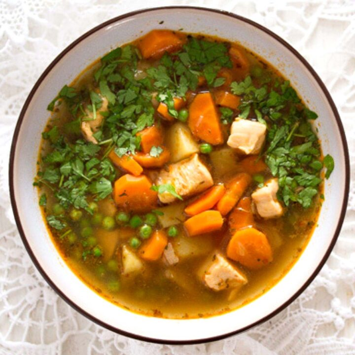 soup with chicken breast and vegetables in a bowl.