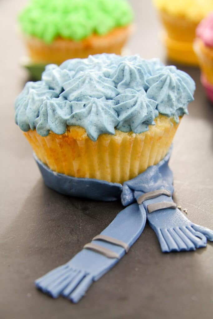 ravenclaw muffin topped with blue whipped cream