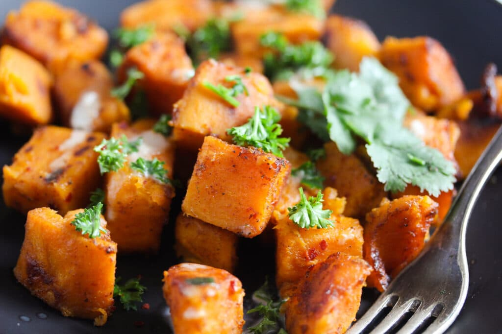 close up tender cubes of orange sweet potatoes