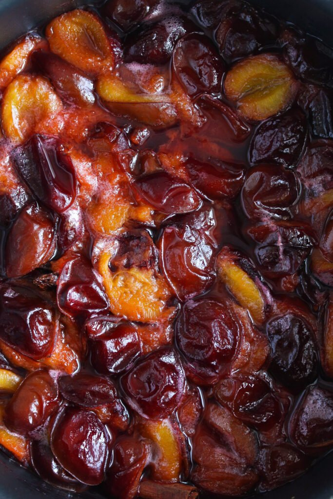 close up of red and shiny stewed plums