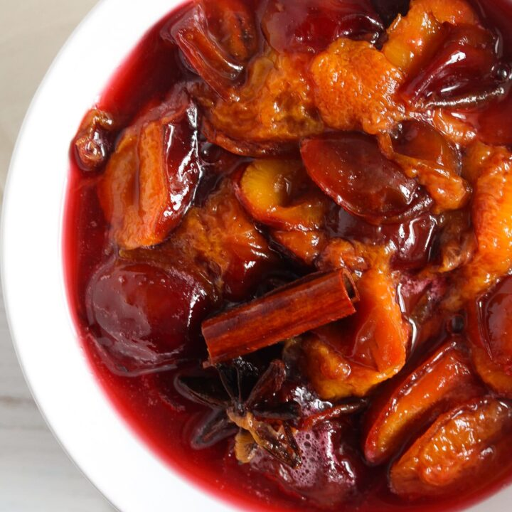 poached fruit in a white bowl