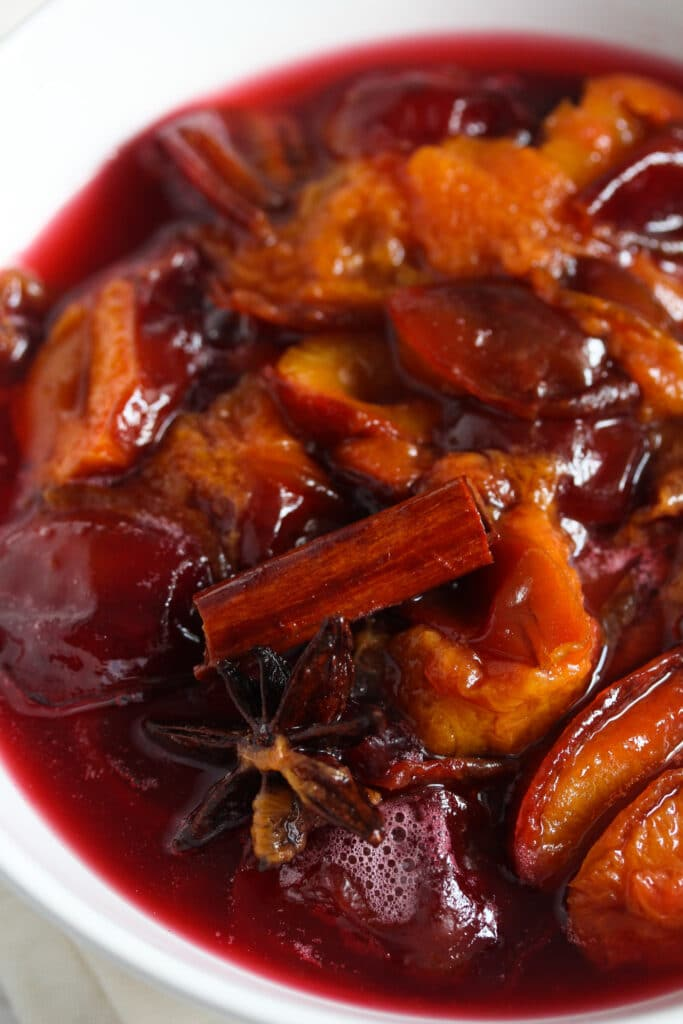 close up bowl of poached Italian plums