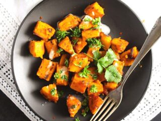 sauteed sweet potatoes served with tahini sauce and cilantro