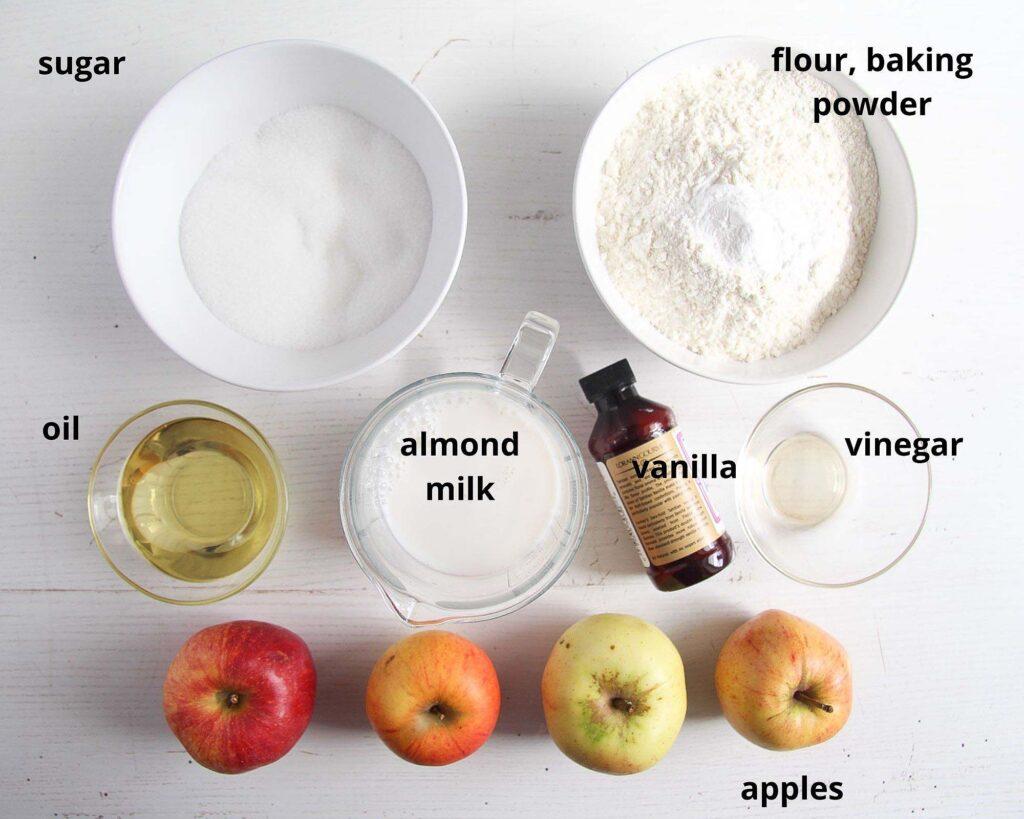 apples, sugar, flour, oil, nut milk on a white table
