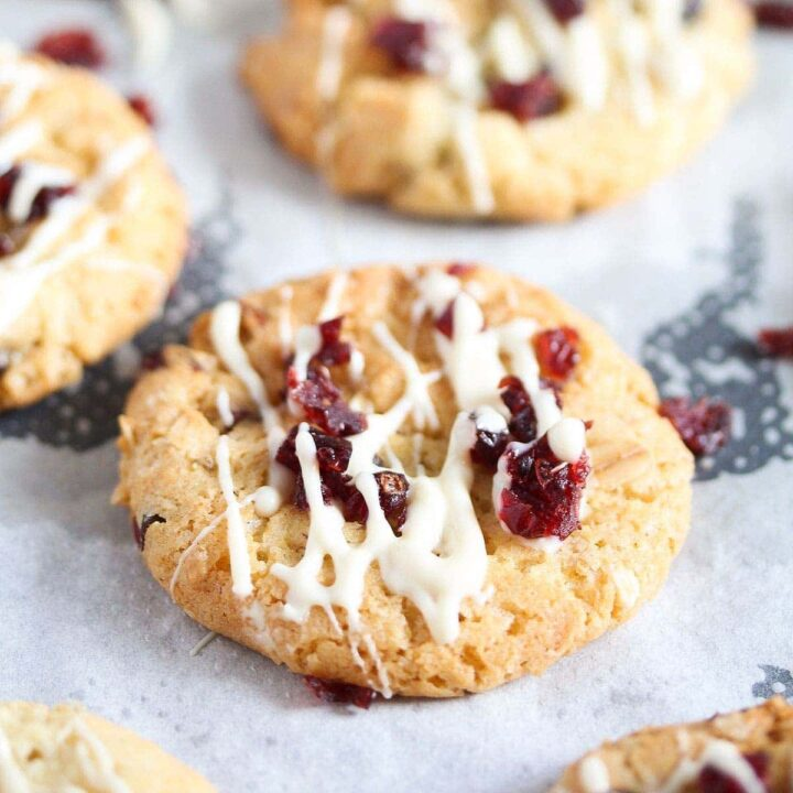 cranberry oatmeal walnut cookie drizzled with white chocolate