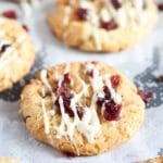 oatmeal cookies with white chocolate and cranberries on baking paper
