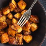 cinnamon squash cubes in a dark bowl