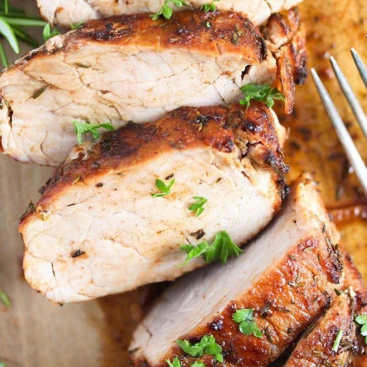 air fryer pork tenderloin sliced on a board