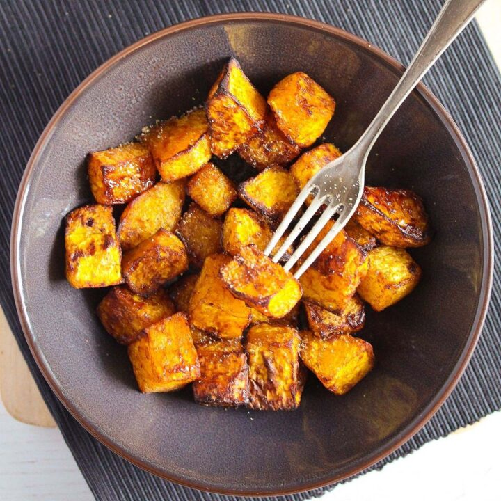 air fryer butternut squash served in a brown bowl