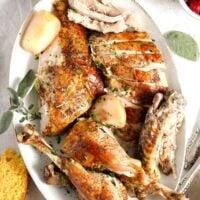 carved dutch oven turkey arranged on a white platter